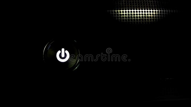 The on-off button glows on a black metal background And glow lines  with innovation concept, the development of technology and the stock photos