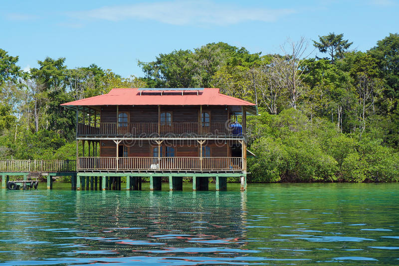 Off grid Caribbean house over water solar powered royalty free stock image