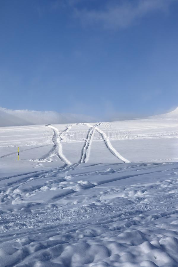 Off-piste ski slope with new-fallen snow and traces from skis, s stock image