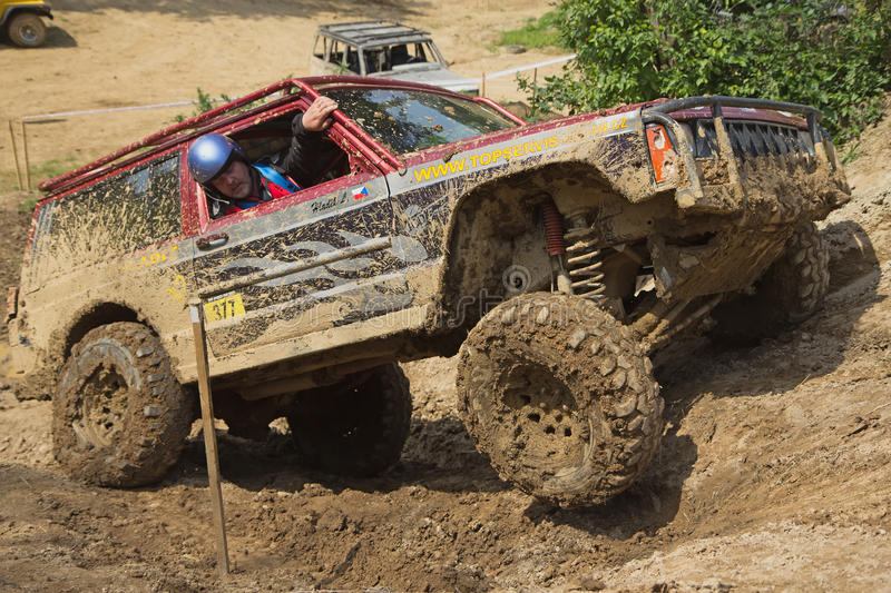 Off-road car on a steep slope royalty free stock photos