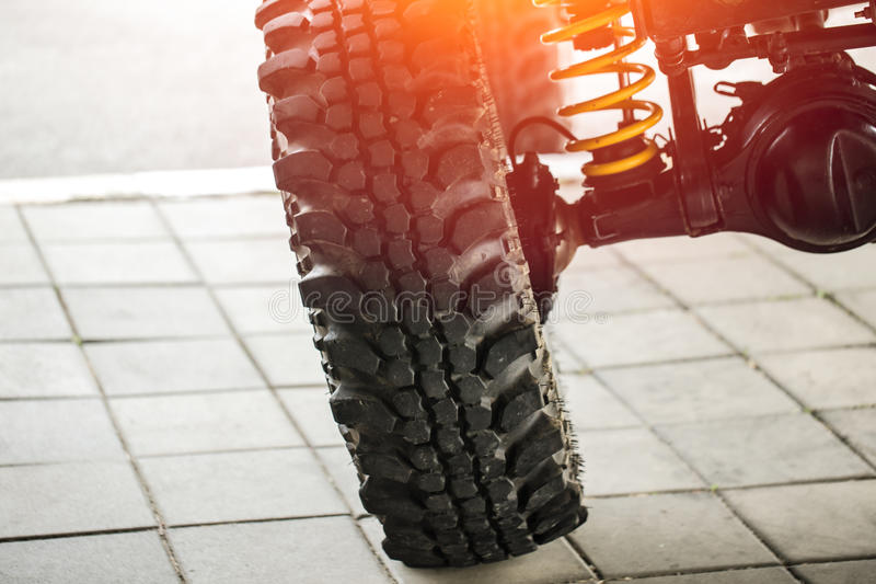 Off-road car tilted show suspension and shock-up. System and mud tire for adventure royalty free stock photos