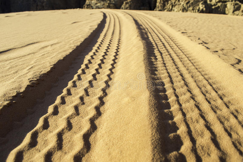 Off road in the desert. Tyre tracks on the desert in jordan stock photography