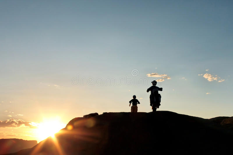 Download Off Road Motor Bikers At Sunset Royalty Free Stock Photography - Image: 24261647
