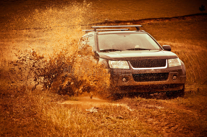 Off Road Mud Splash. A modern off road car, splashing the mud royalty free stock photography