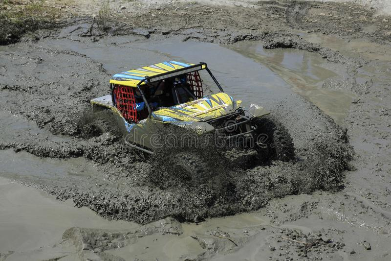 Off Road Mudflow Puddle in Summer Competition. Yogyakarta, Indonesia, 14/05/2017: Adrenaline sports an offroad car cross a dirty mud puddle in a summer