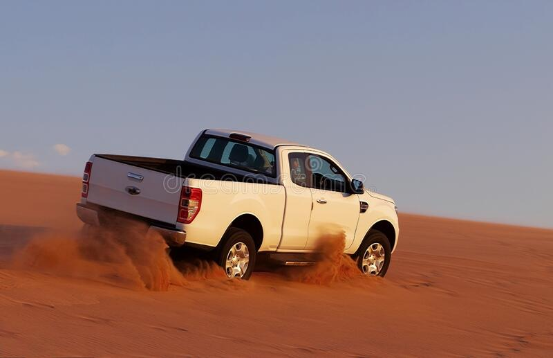 Off-road safari on the golden sands of the desert on a white car in Walvis Bay. Namibia. Off-road safari on the golden sands of the desert on a white car in royalty free stock images