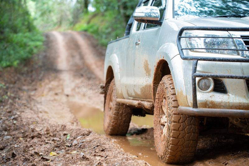 Off-road tires, Dirty offroad car, SUV covered with mud on countryside road. offroad travel and driving concept.  stock photos
