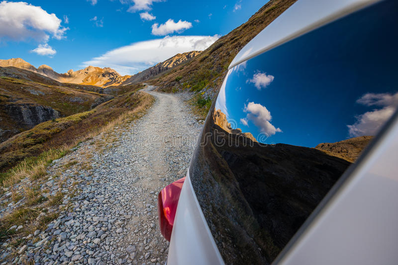 Off Road Trail reflection in car window Clear lake San Juan Mountains royalty free stock photography