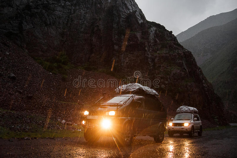 Off-road travel on 4x4 jeep car in mountains. Team of adventurers. Altay mountains, tourist in Siberia, nature views of Russia. Off-road travel on 4x4 jeep car stock photography