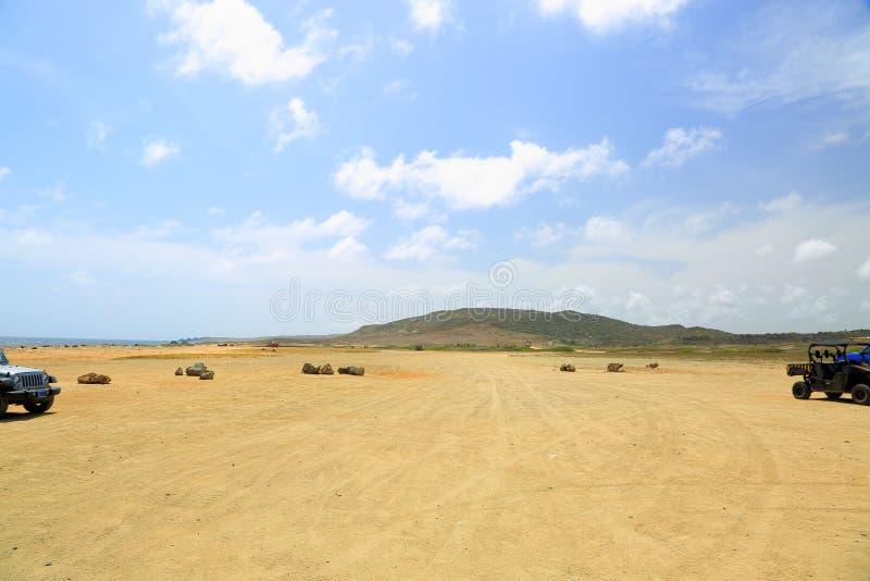 Off-road UTV Aruba tour. Amazing stone desert landscape and blue sky stock photo