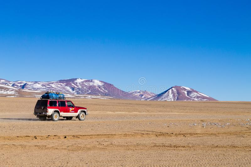 Off road vehicle on Bolivian andean plateau royalty free stock photo