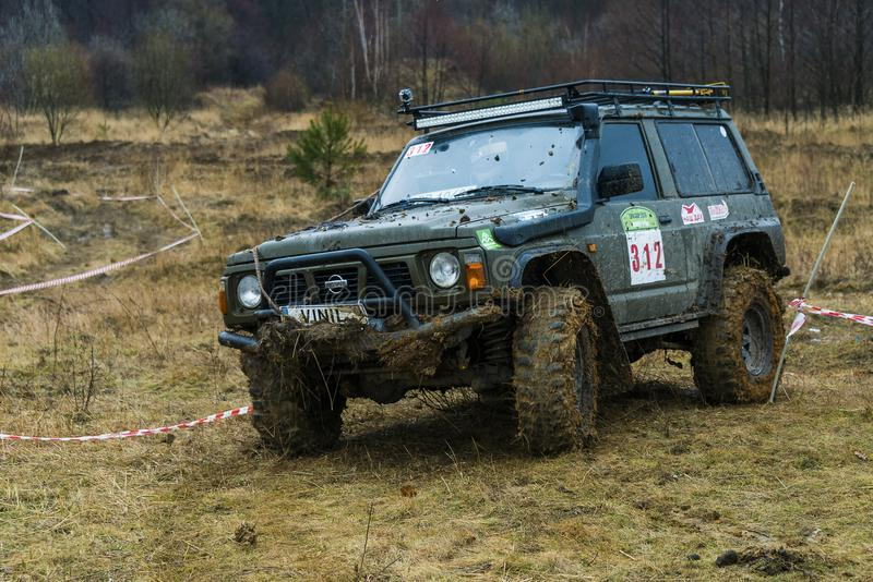 Off-road vehicle brand Nissan No. 312 overcomes the track royalty free stock photography