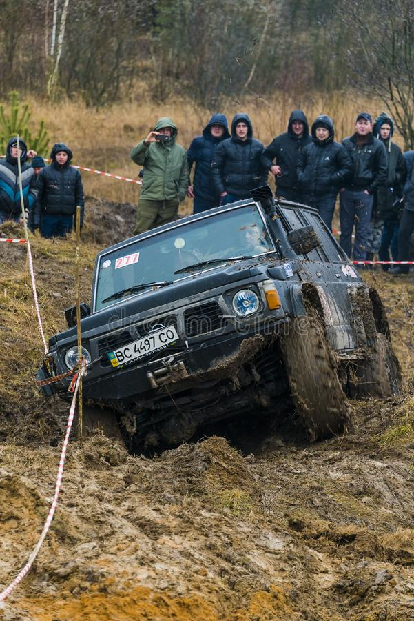 Off-road vehicle brand Nissan No. 277 overcomes the track stock photo