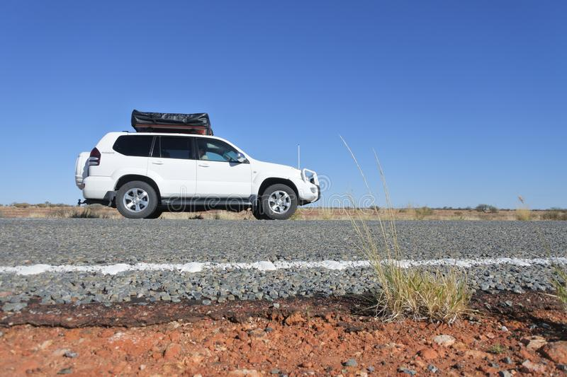 An off road vehicle driving on Stuart Highway in Central Australia royalty free stock image
