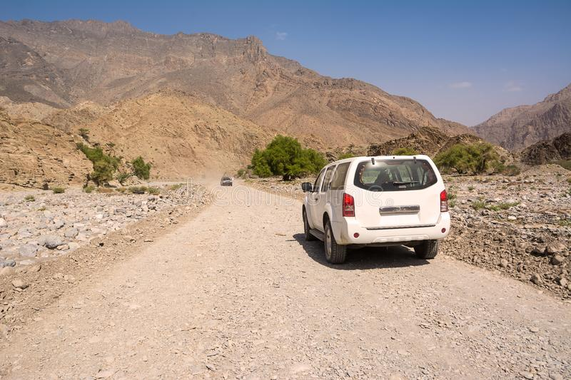 Off-road vehicle on the Jebel Shams mountains stock image