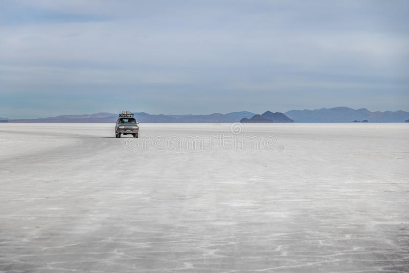 Off-road vehicle in Salar de Uyuni salt flat - Potosi Department, Bolivia stock image
