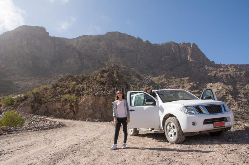 Off-road vehicle and tourists on the Jebel Shams mountains stock images