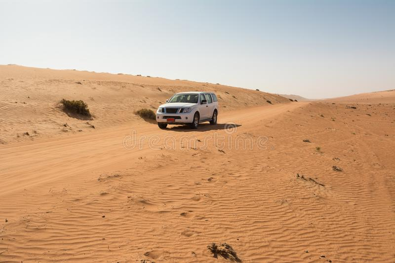 Off-road vehicle on a track in the Wahiba Sand Desert royalty free stock image