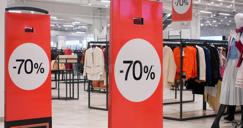 70 off sale banner at the mall. 70 off sale banner at the clothing store royalty free stock images
