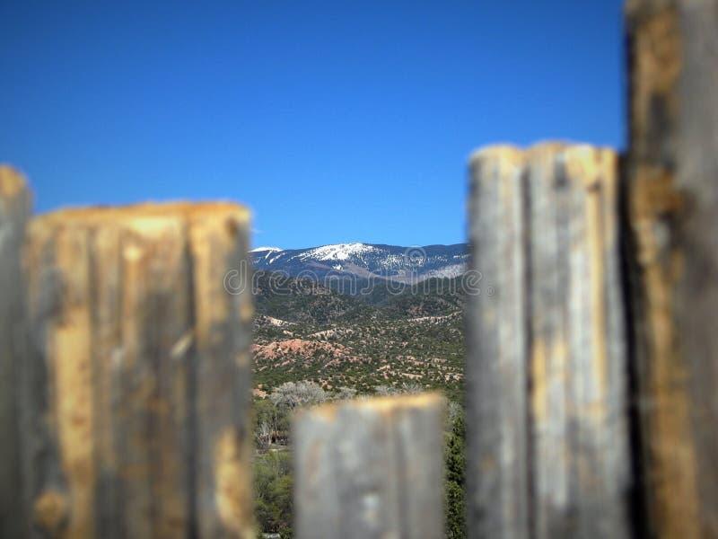 Santa Fe ski basin, the Southern tip of the Sangre de Cristo Mountains, visible through a fence royalty free stock photography