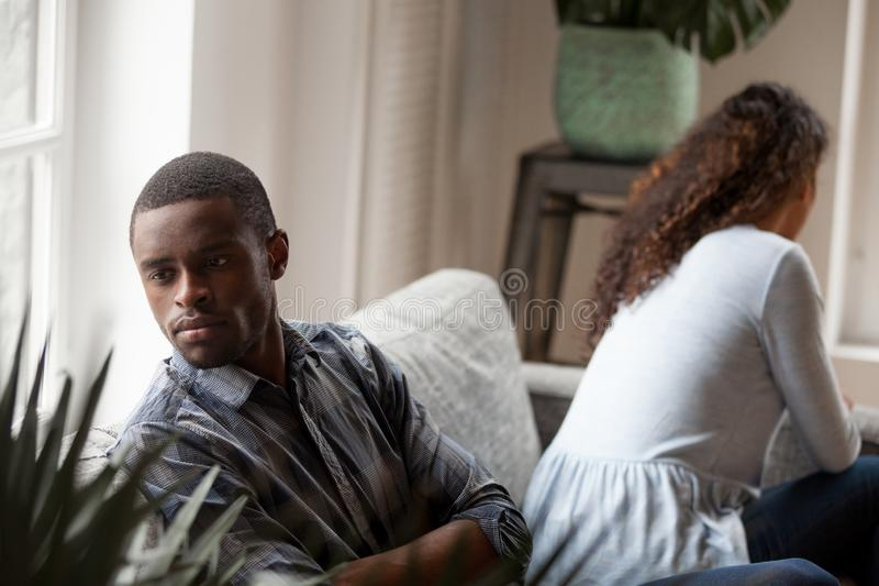 Offended African American couple sitting separately after quarre royalty free stock photo