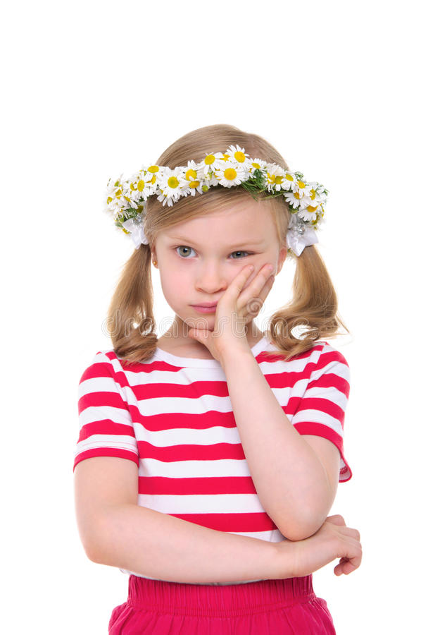 Offended girl with wreath of daisies royalty free stock images