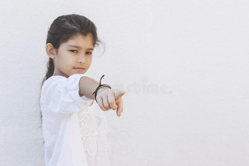 He Offended Me. School girl saying it`s him pointing with her finger. Showing hand gesture this is him, he hurt me. Negative emotions. The upset girl points to stock image