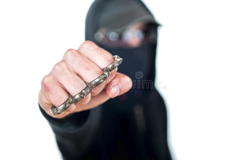 An offender with Brass knuckles stock photos
