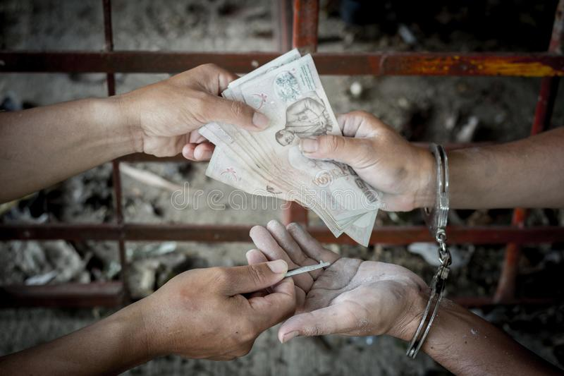 Offenders give money in exchange for release, stock photo