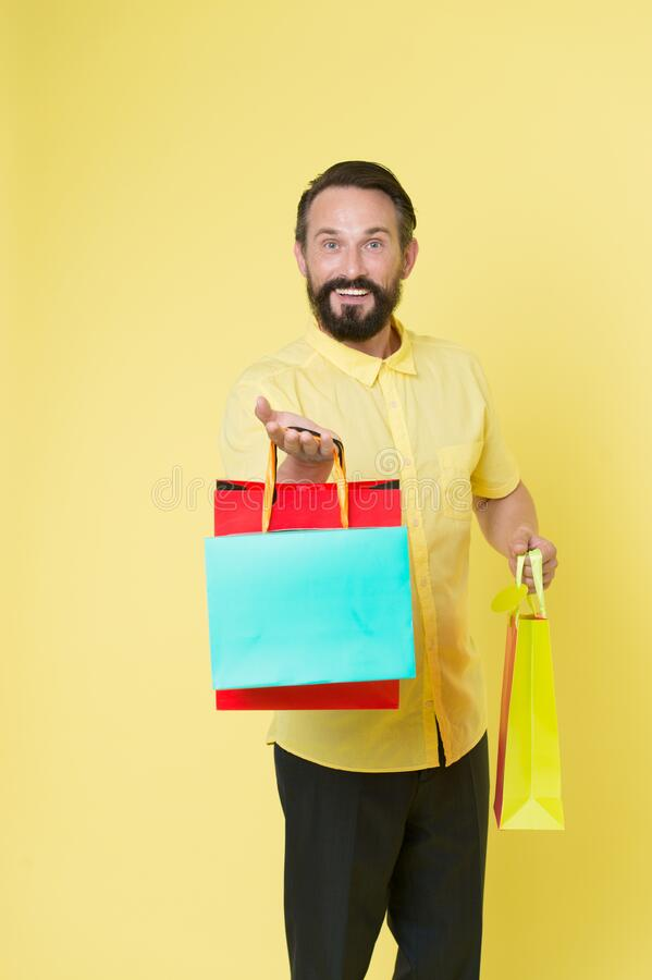 Offer bonus for client good idea. Man mature bearded cheerful face holds shopping bags. Man got unexpectable gifts. Guy royalty free stock photos