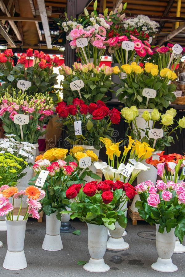 Offer fresh cut flowers at street shop royalty free stock photos