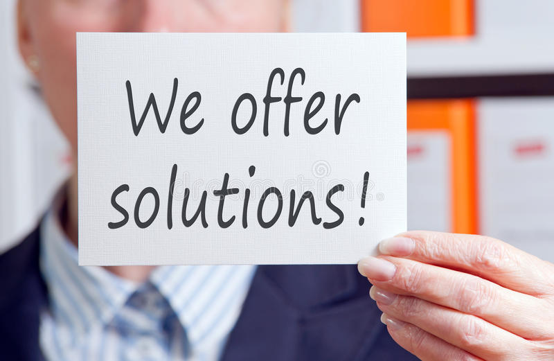 Download We Offer Solutions Card Or Sign Stock Image - Image of holding, solutions: 39502127
