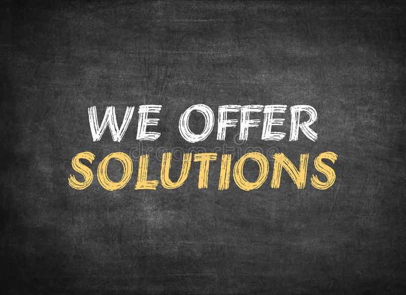 We offer solutions. On chalkboard background royalty free stock photo