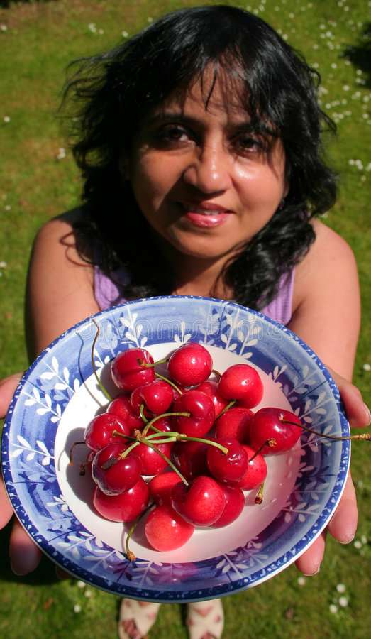 Download Offering Cherries stock photo. Image of smiling, food, asian - 988078
