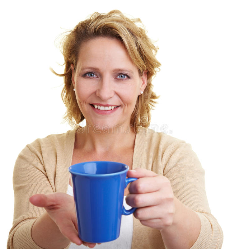 Offering coffee. Happy woman offering a cup of coffee stock photos