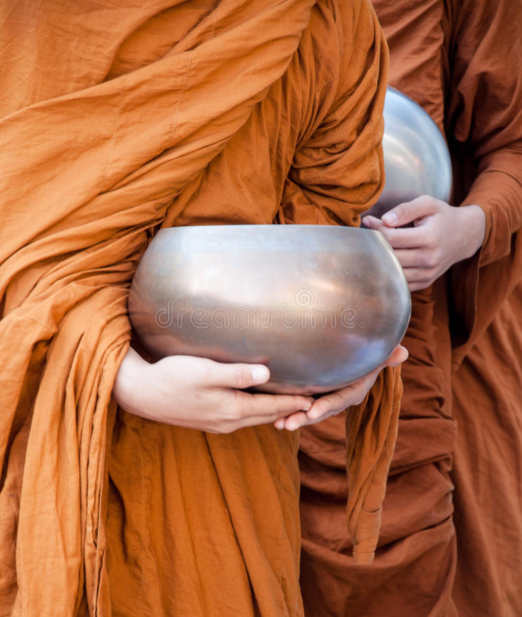 Food offering to a monk. Offering food is one of the oldest and most common rituals of Buddhism. Food is given to monks during alms rounds. Offering food is a royalty free stock photography