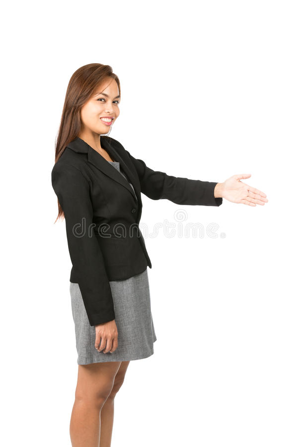 Offering Handshake Smiling Asian Side At V. Side view of light brown haired Asian woman in black, gray business clothes smiling greeting, offering handshake stock photo