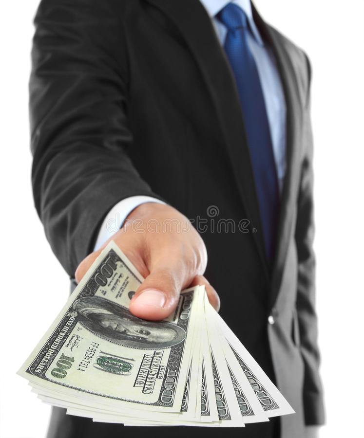 Offering money. Close up of businessman's hand offering money isolated over white background royalty free stock image