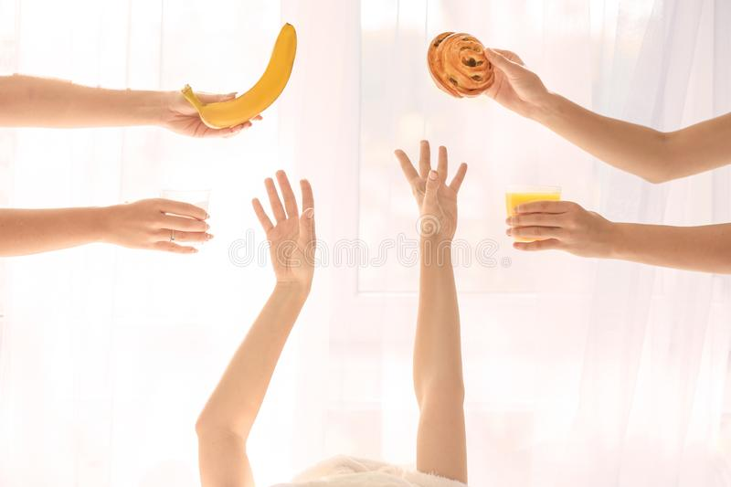 Offering of tasty breakfast to sleepy woman at home royalty free stock photos