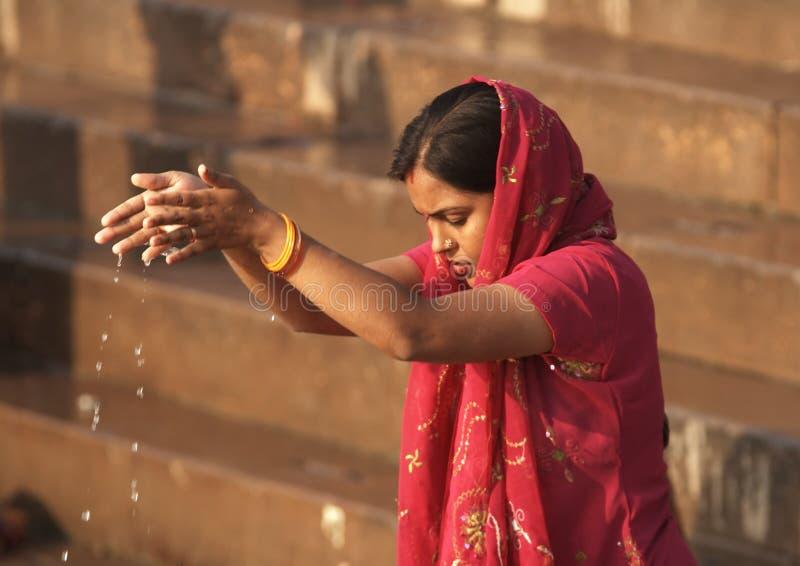 Varanasi - India - Woman Making an Offering to the Gods stock photos