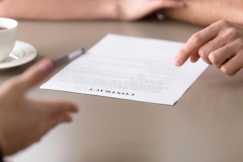 Offering to sign and discussing business contract concept, close stock image