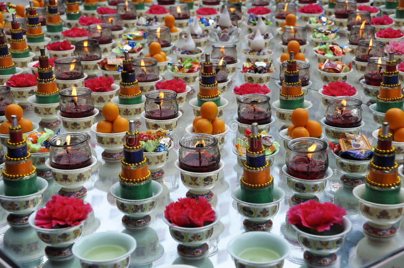 Offerings. Toaist prayer offerings of lotus shaped candles and jars at a temple. photo taken on:May 3th 2011 stock photography