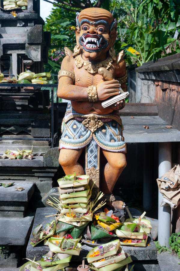 Download Offerings Are Made To A Traditional Balinese Statue, Bali, Indon Stock Photo - Image: 28398486
