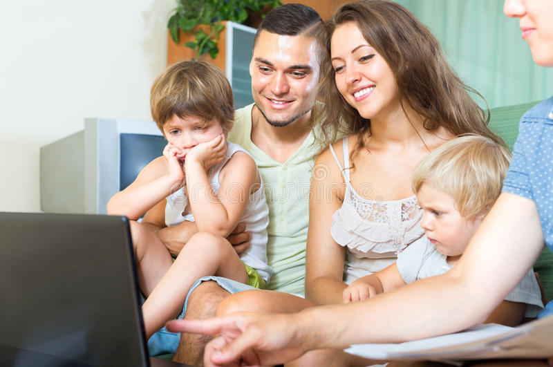 Offers insurance agent. Young family of four people listening to offers insurance agent stock photos