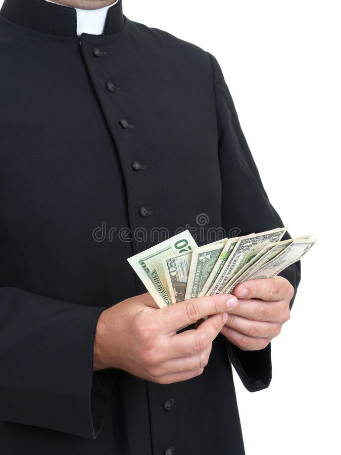 Offertory. Catholic priest with bunch of dollar banknotes stock photography