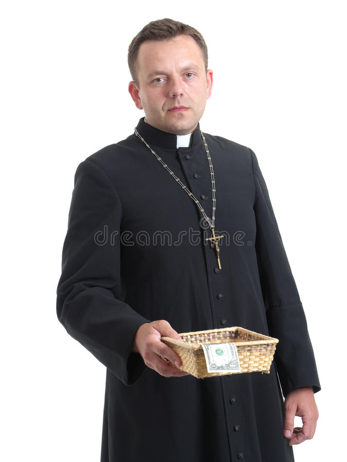 Offertory. Catholic priest with collection plate royalty free stock photography