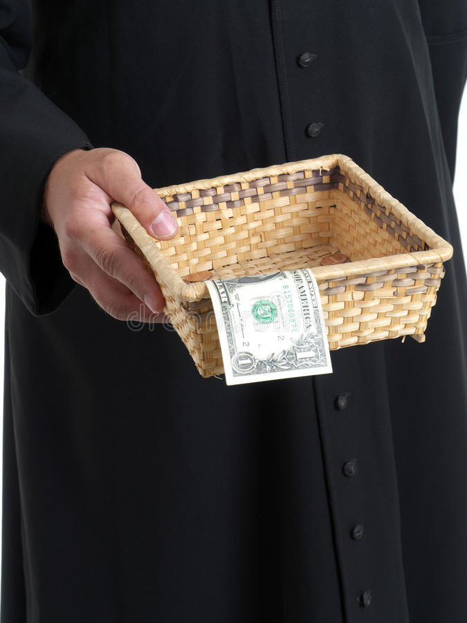 Offertory. Catholic priest with collection plate stock photos