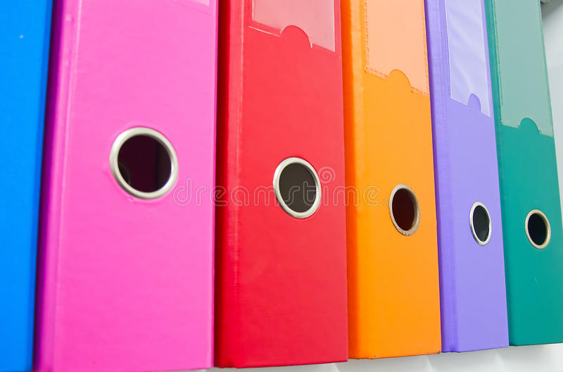 Office. Colorful office folders on the bookshelf royalty free stock images