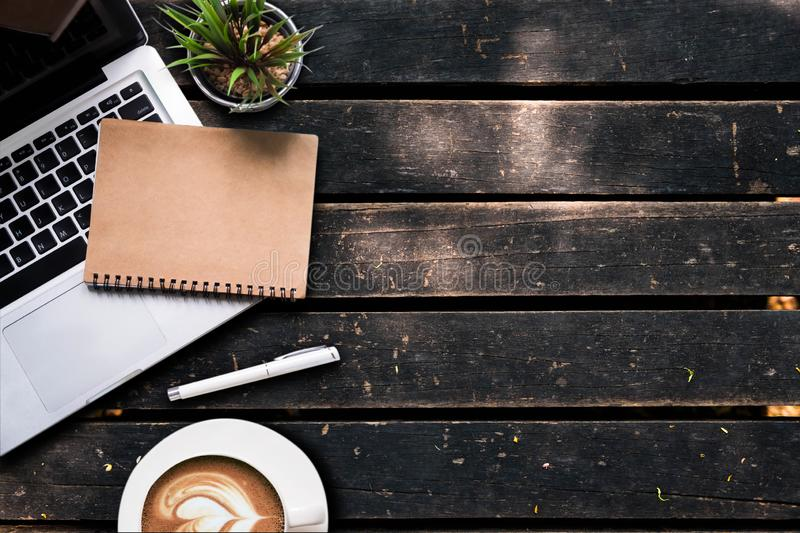 Office accessories laptop, smartphone, notepad, and coffee cup on cement wall table background. Office accessories laptop, smartphone, notepad, and coffee cup royalty free stock photos