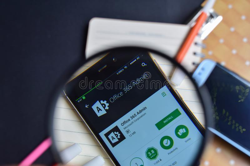Office 365 Admin App with magnifying on Smartphone screen. royalty free stock photo